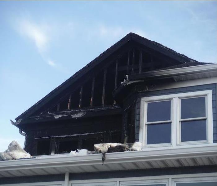 Home with visible fire damage on the upper floor