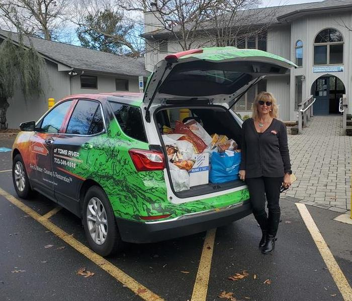 Picture of SERVPRO of Toms River car filled with food at OceanMHS for Thanksgiving Food Drive 2020