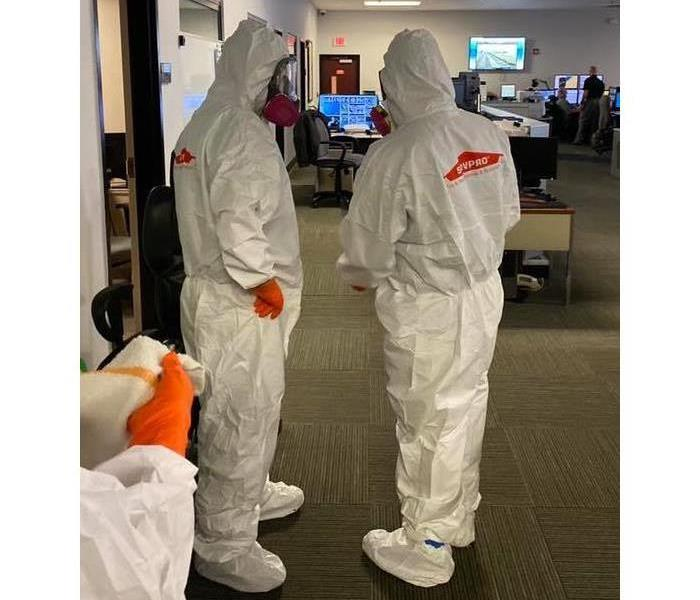 SERVPRO of Toms River in hazmat suits disinfecting Ocean County Sheriff Communications Center
