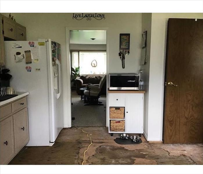 Kitchen with floor tiles missing