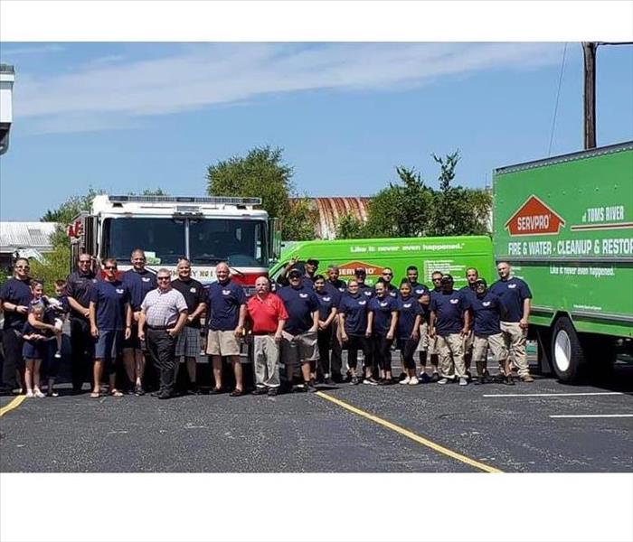 SERVPRO of Toms River owner Michael Reilly presented 11,000 bottles of water to Toms River Fire Commissioners.